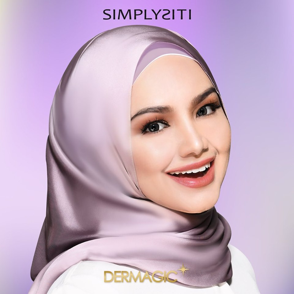 Celebrity Siti Nurhaliza in satin purple hijab endorsing her beauty brand