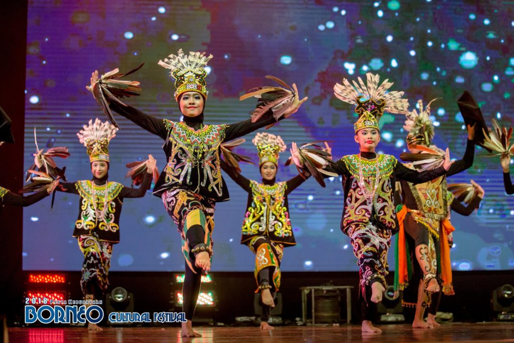 Traditional dance by dancers in costume on stage