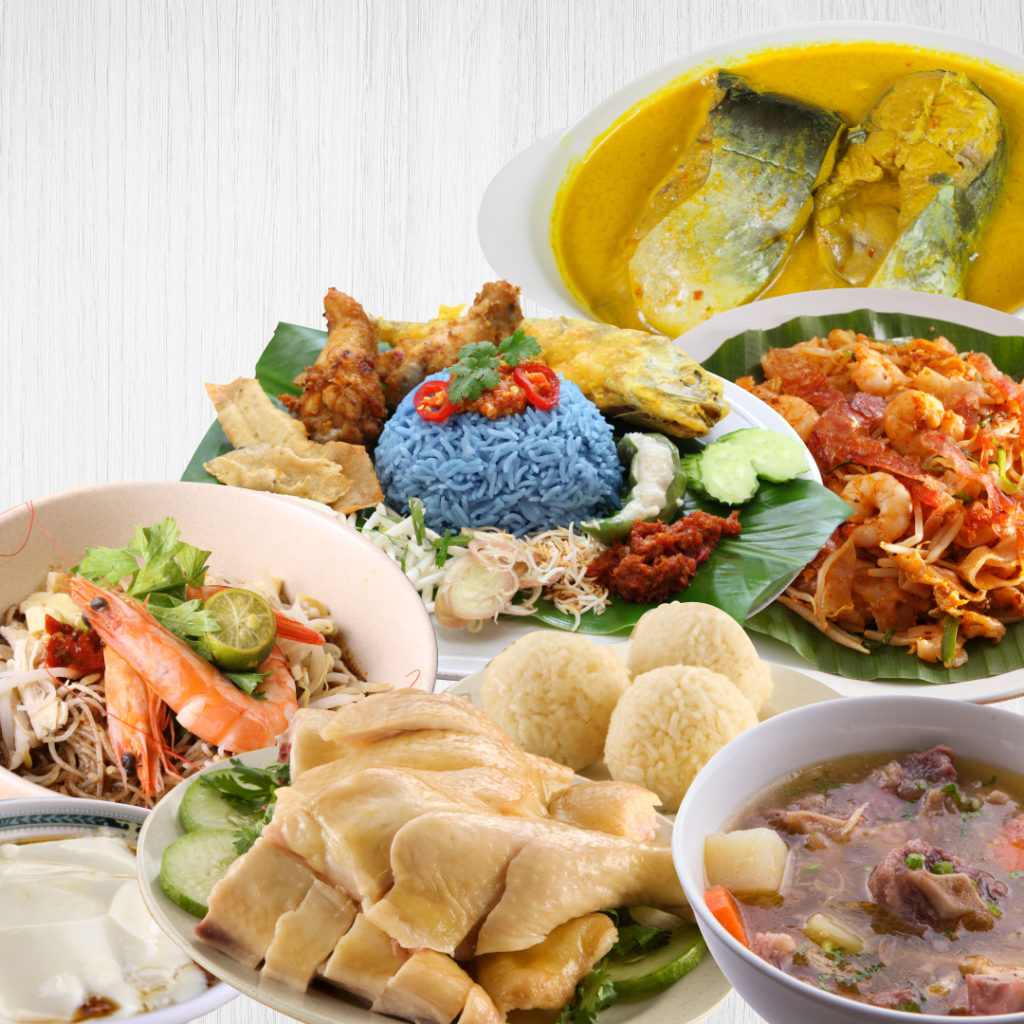 Variety of dishes including Kelantan nasi dagang with blue rice, steamed chicken and seafood platter