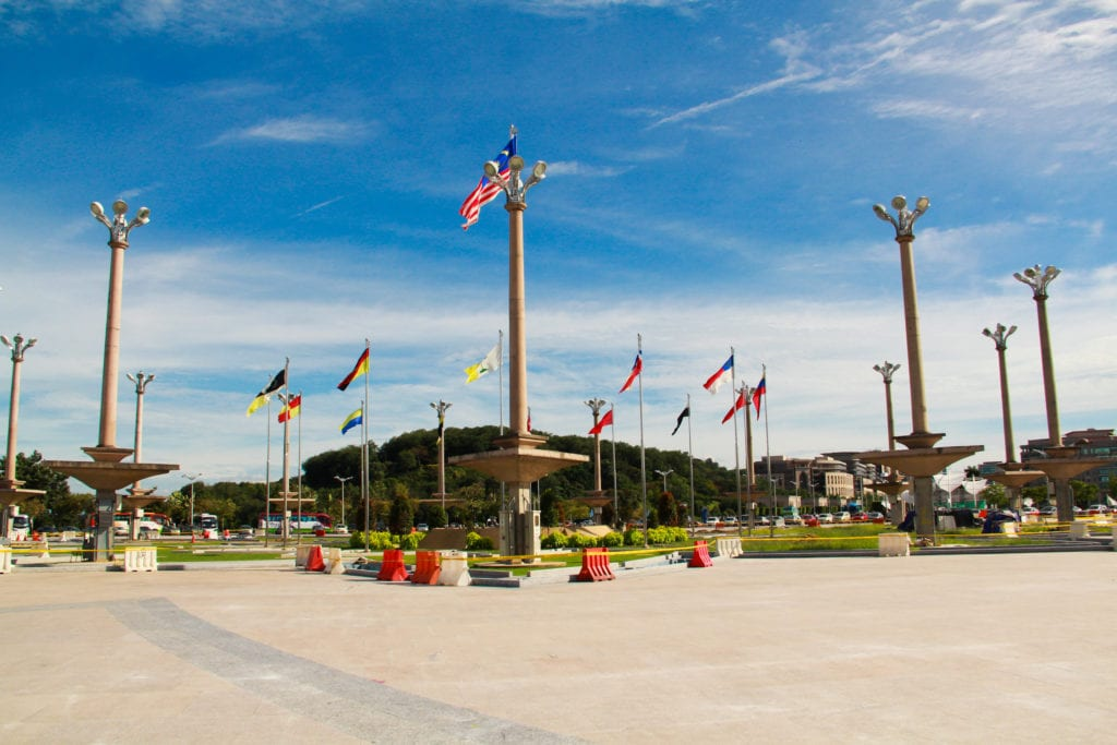 Putrajaya with Malaysia flags on posts against blue skies