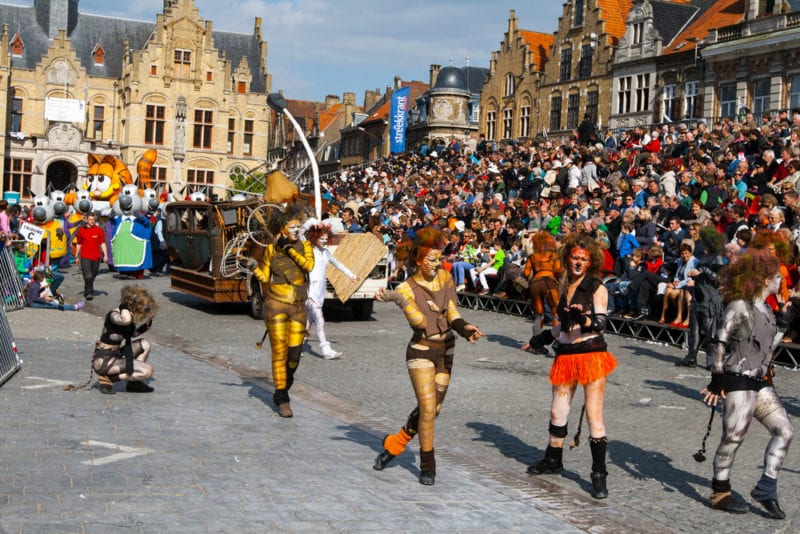 performers dressed up as cats parading streets of Belgium