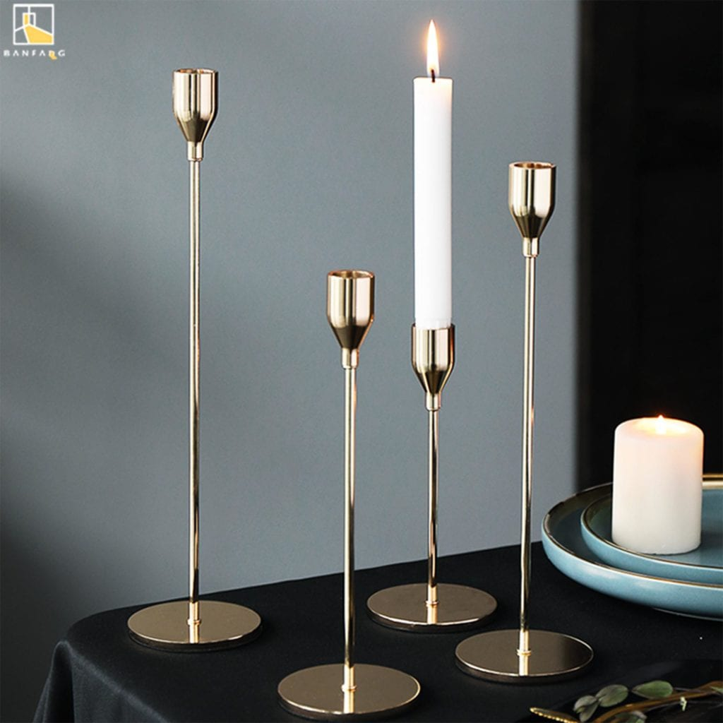 4 tall slim candlestick holders in gold