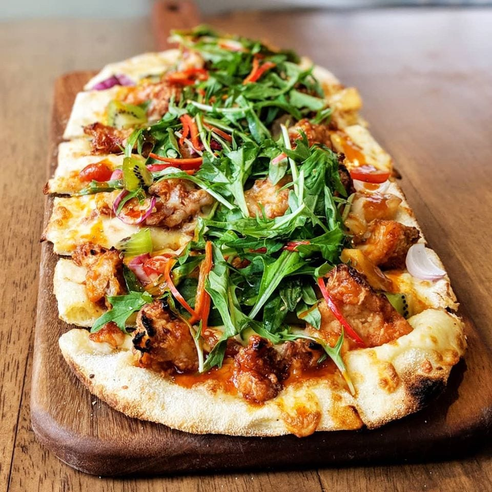 Rustic pitzaal - baked bread with toppings and sauce