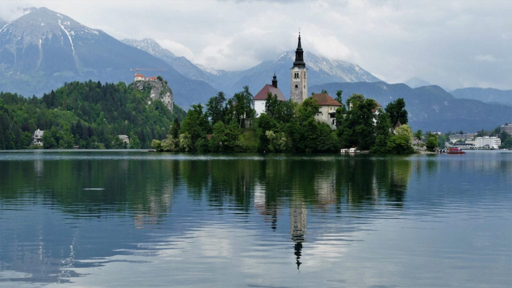 Lake Bled in Slovenia with castle in background and clear waters