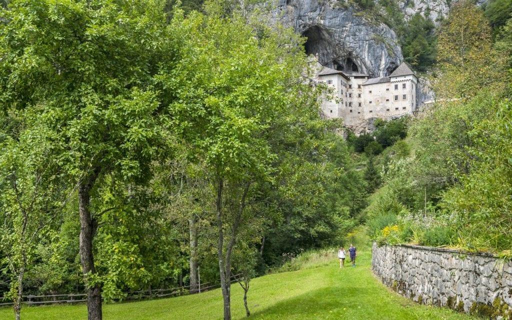 Predjama Castle with greenery all around