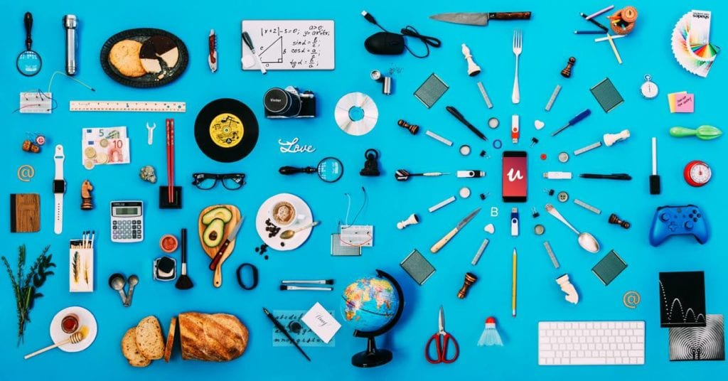 Tools, stationery and variety of items on blue table