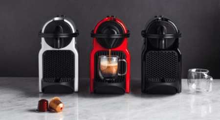 white, red and black coffee machine from nespresso