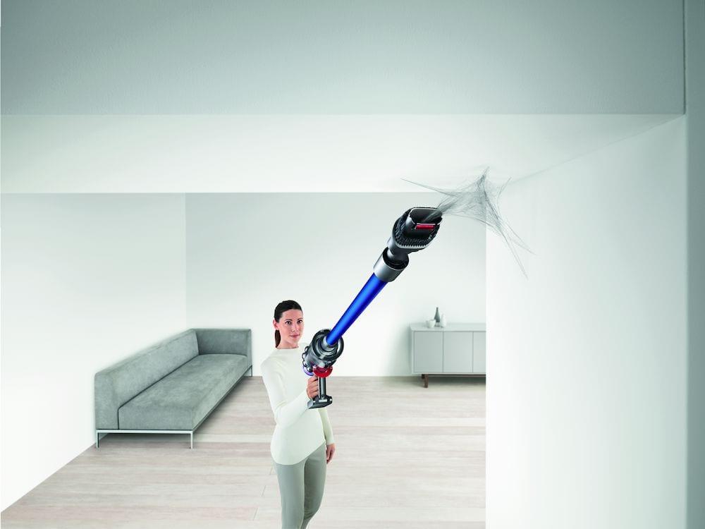 woman using dyson vacuum