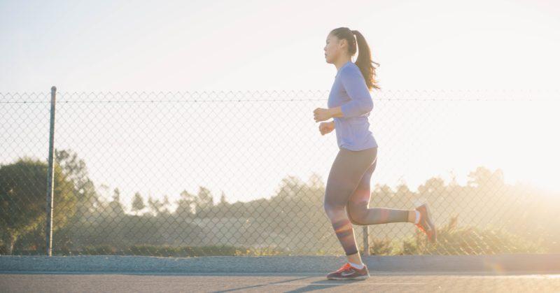 Asian girl running in the morning