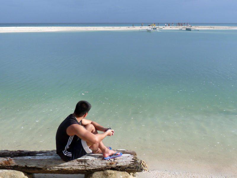 Man on the beach admiring the sea on Bantayan Island