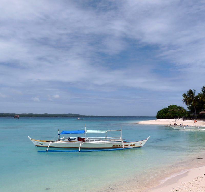 Boat at the beach shore on Bantayan Island