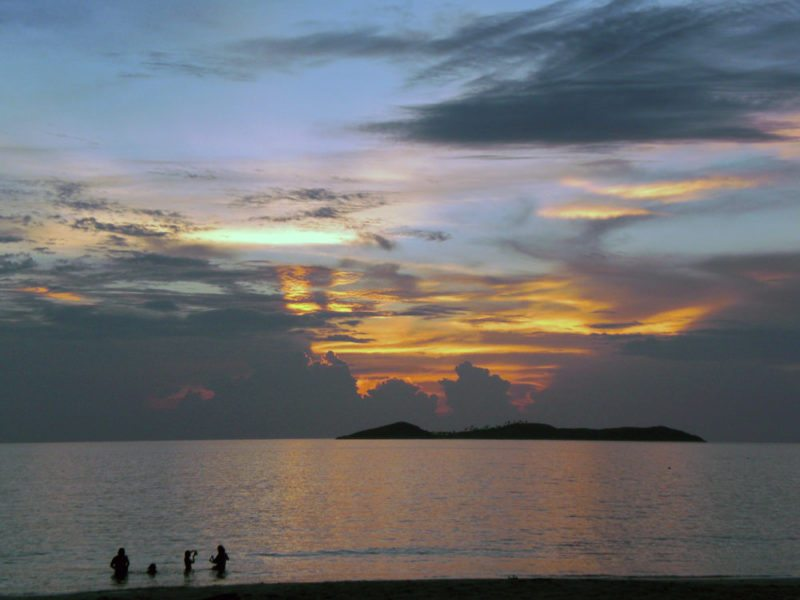 People at the beach in Calaguas during sunset