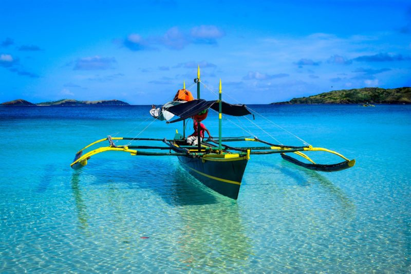 Go island hopping around Calaguas in a colourful toruist boat