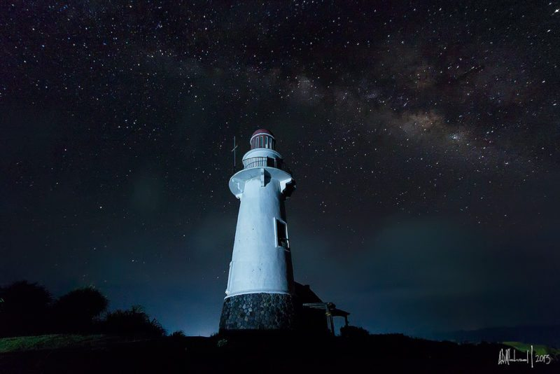 Naide lighthouse at night against the most beautiful starry sky