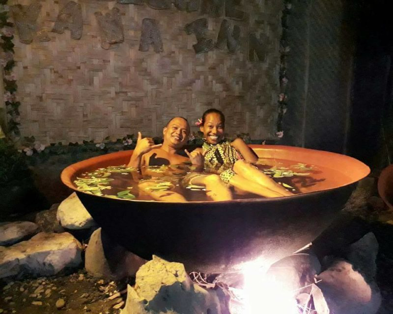 Couple having at Kawa Hot Bath at Kawa Inn, Tibiao, Antique