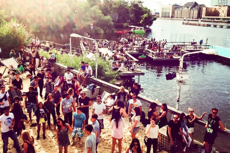High Angle View Of People Partying By Lake In City