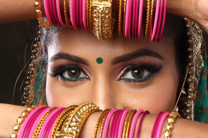 Indian lady with pink bangles and long dark lashes