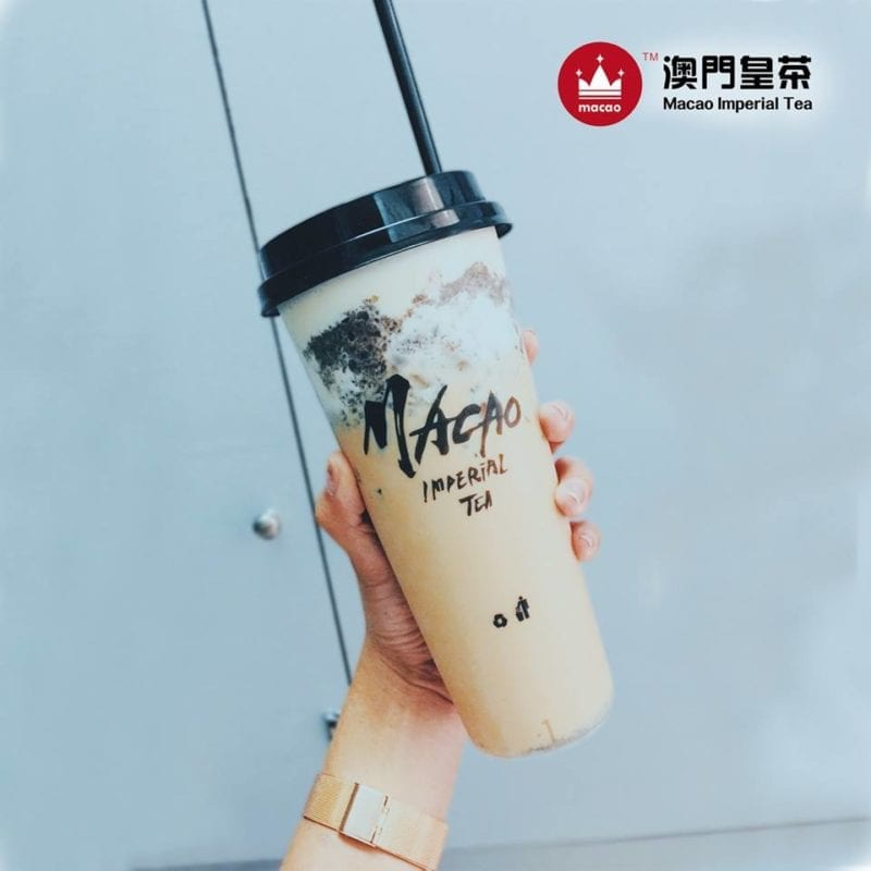 hand holding upsized cup of Macao Imperial Tea