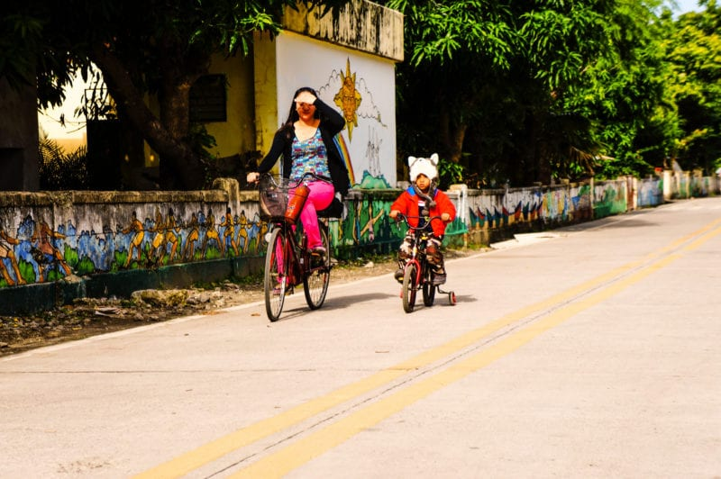 lady and child biking on the roads of Batanes