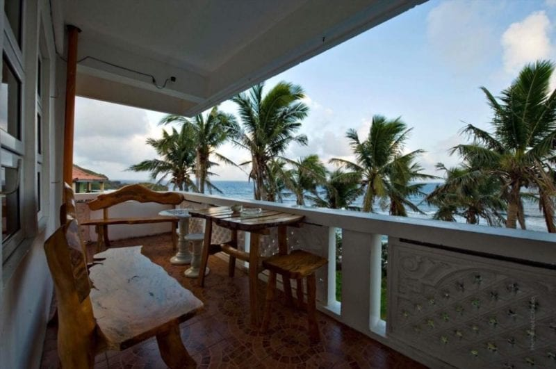 Batanes Seaside Lodge balcony looking out to palm trees