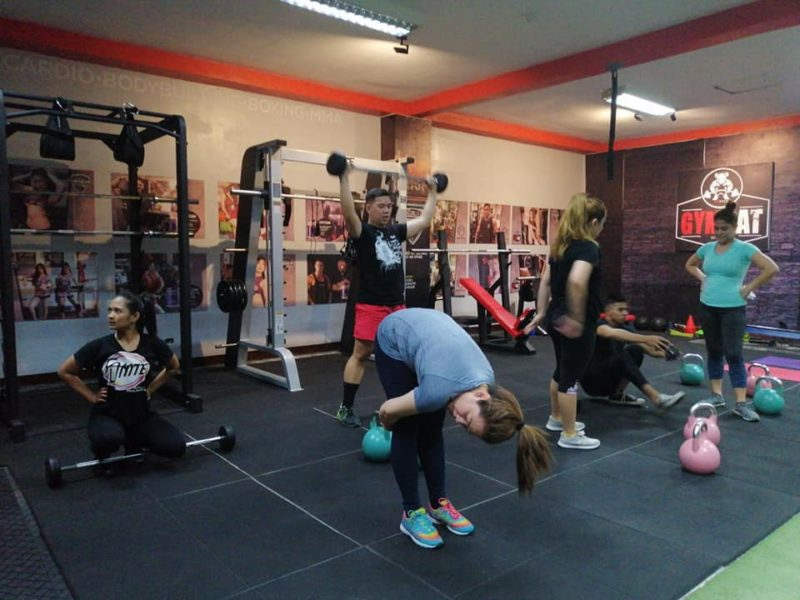 open gym area with members exercising