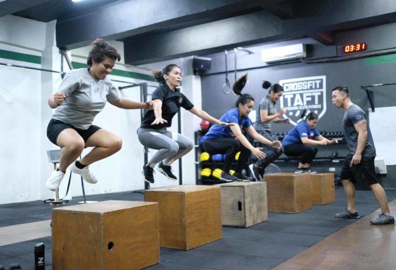 ladies jumping atop wooden blocks workout