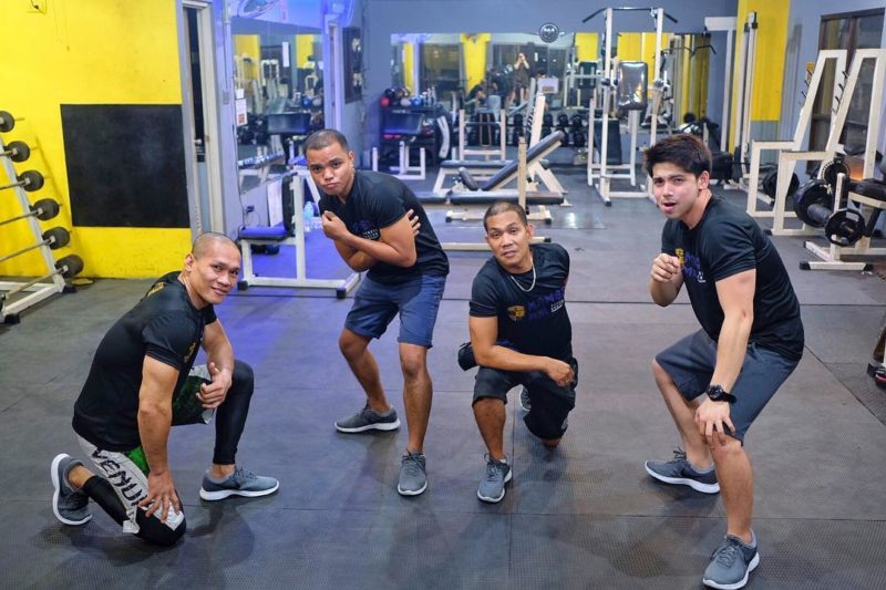 4 personal trainers posing at Mamba MNL