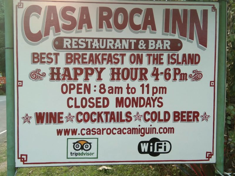 Signage of Casa Roca Inn showing opening times and specials