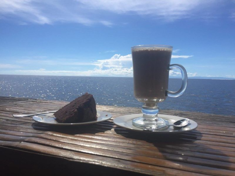 Cake and coffee served overlooking the sea