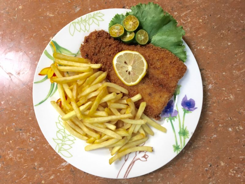 Traditional Fish & Chops on white plate