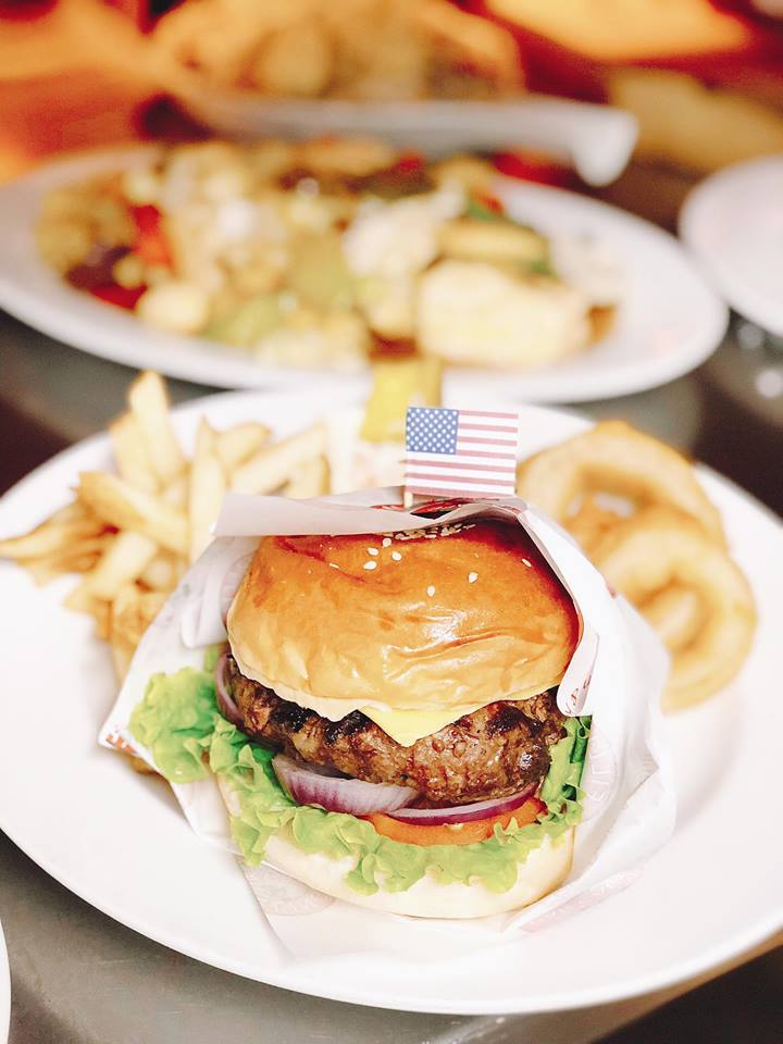 all American burger with fries and onion rings