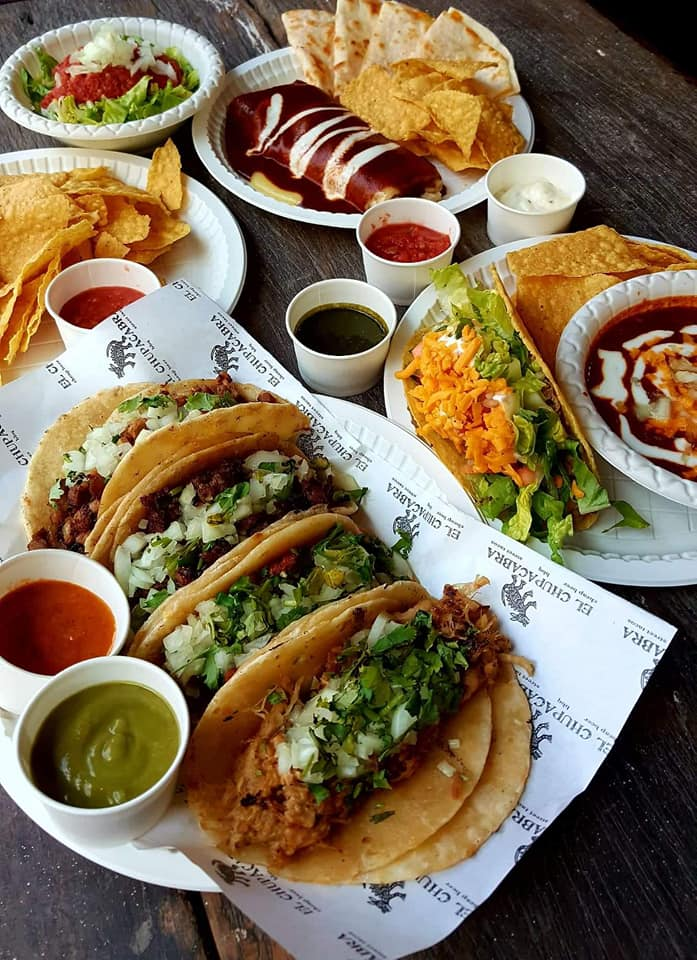 Mexican tacos and nachos with dipping sauces