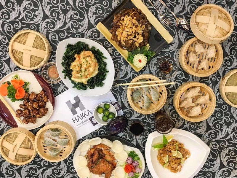 Hakka cuisine and dim sum served on plates on table