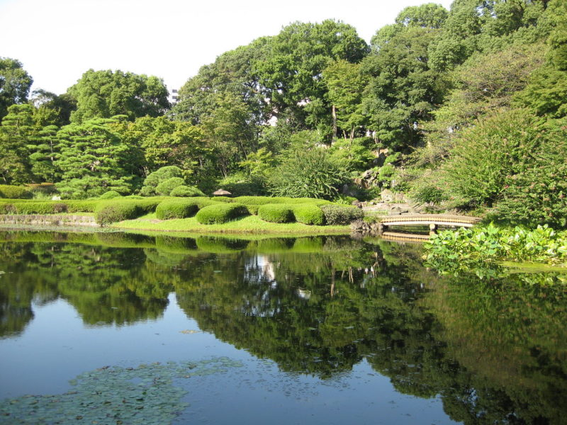 Lake waters reflecting trees in Imperial Palace Gardens