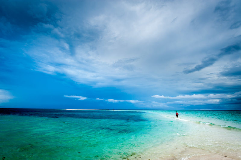Blue seas and white beach of Camiguin with blue skies