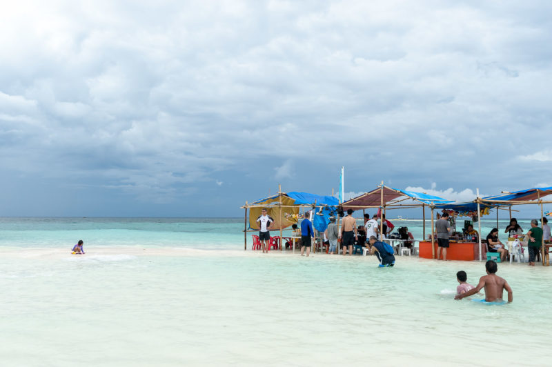 Beach stalls on clear waters in Camiguin