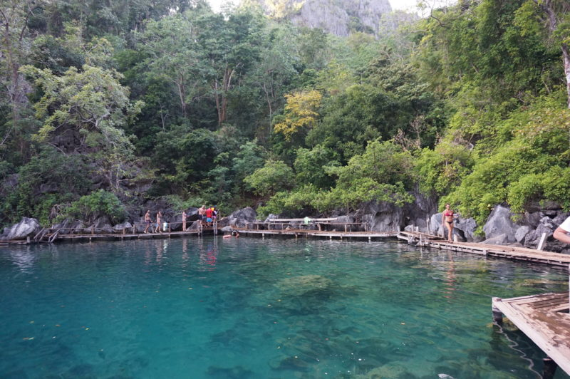 Kayangan Lake with clear waters and green trees at back