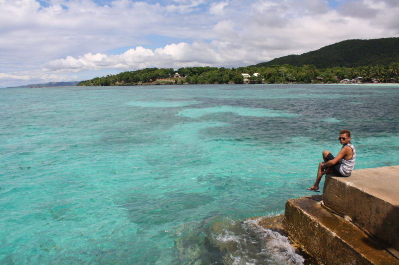 Clear waters of Siquijor by the jetty with mountains at back