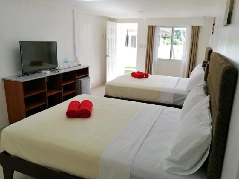Rooms with 2 beds and white sheets plus amenities