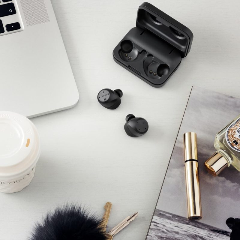 earbuds with case on white table