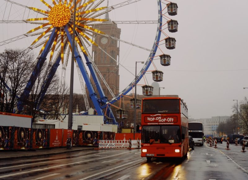 sightseeing bus with ferris wheel