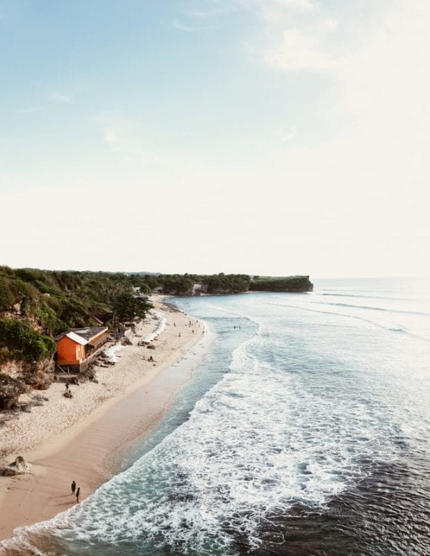 coast line of Bali with a red house