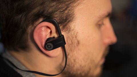guy with beard wearing beats earphones