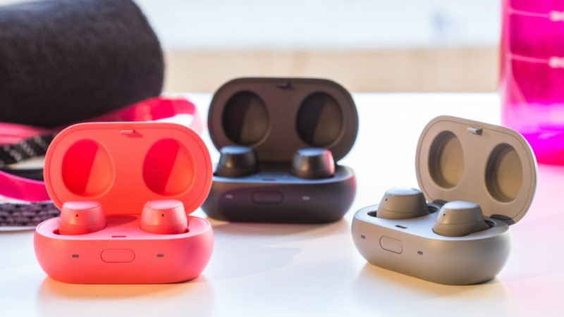 pink black and grey wireless earbuds