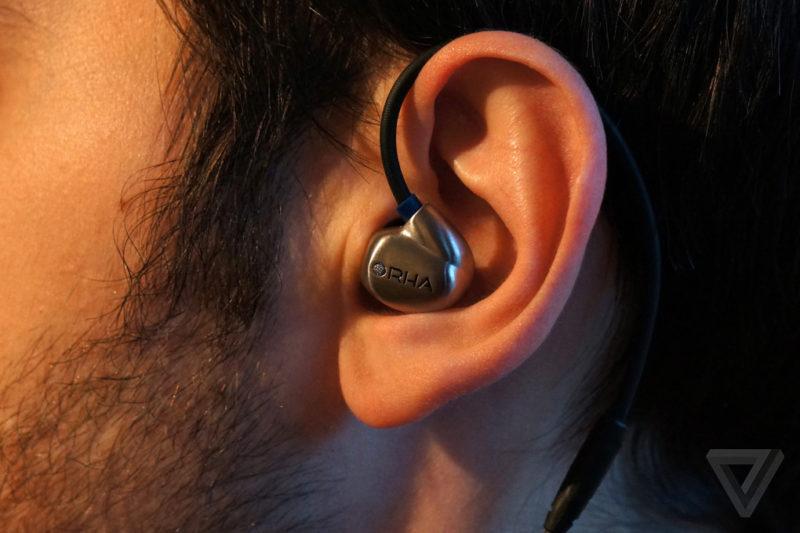 man wearing wired earphones