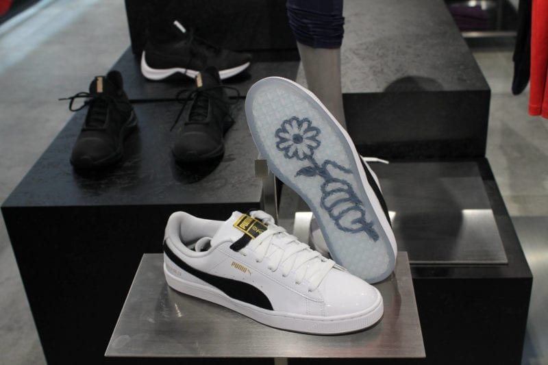 Close-up of PUMA Basket Patent with design of hand holding flower on sole