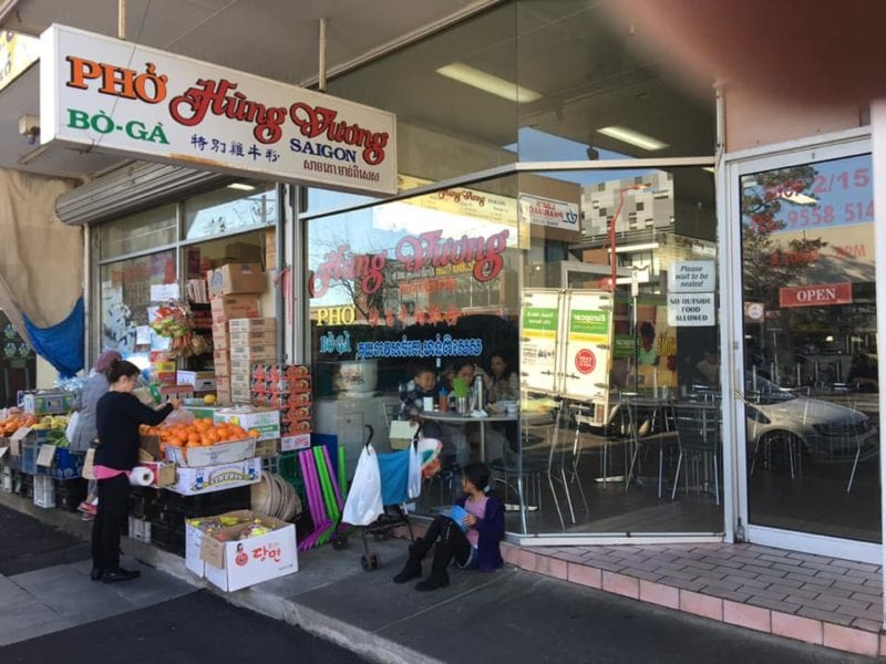 Shop frontage with fruit grocer next door