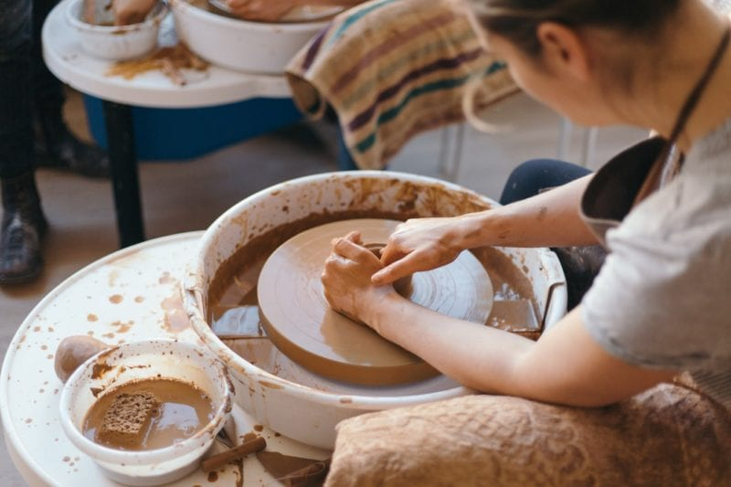 woman making pottery at a pottery class