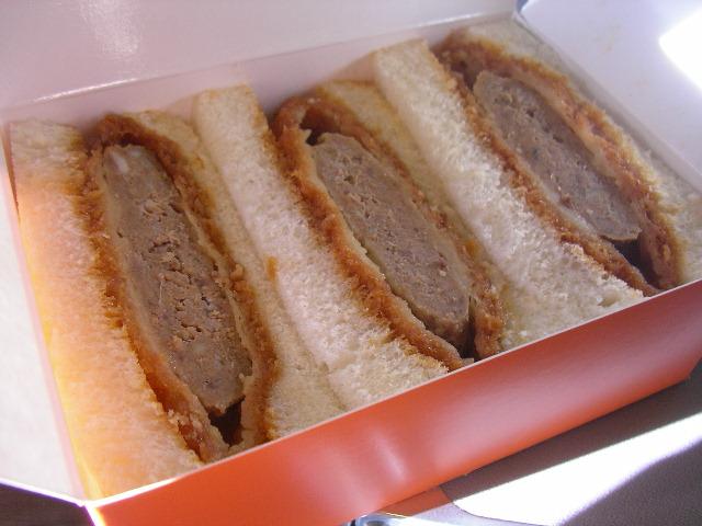 Katsu nestled comfortably between white sandwich bread