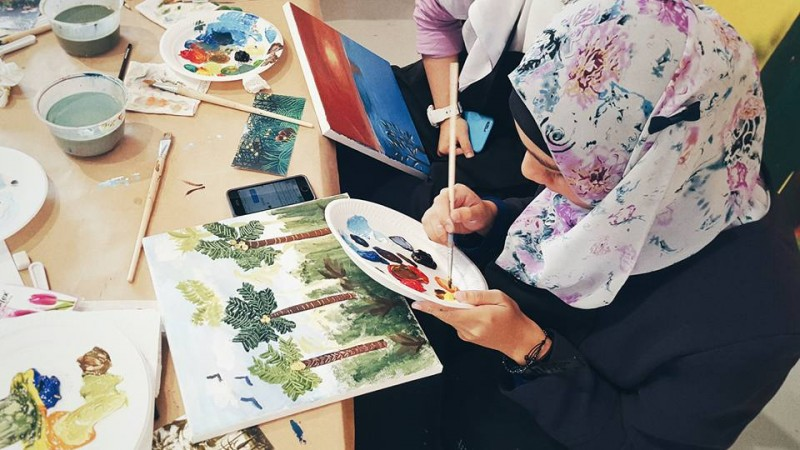 Woman painting trees
